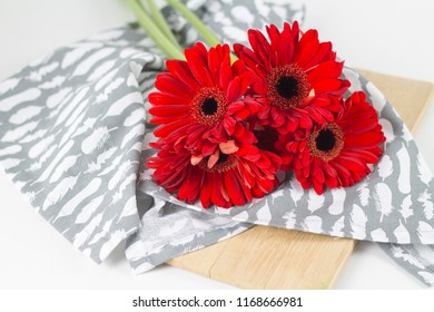 Beautiful fresh red flowers on light background