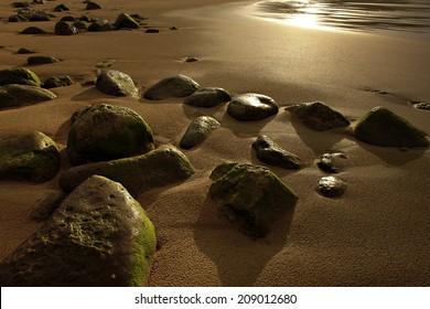 beautiful fresh sand and light -stony beach after the rain