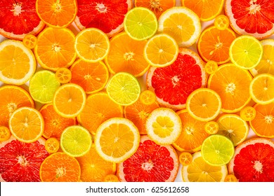 beautiful fresh sliced mixed citrus fruits like background, concept of healthy eating, dieting, top view