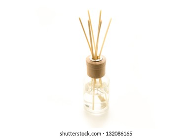 Beautiful fresh smelling incense sticks dipped in a fragrant liquid in a glass jar.