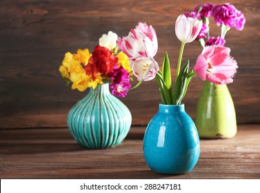 Beautiful fresh spring flowers on wooden background
