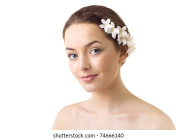 Beautiful fresh spring woman with flowers in her hair and pure skin