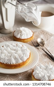 Beautiful freshly made white lemon meringue tart on plate. Lemon meringue pie still life composition. Food photography. table setting. Lemon meringue pie with white meringue peaks