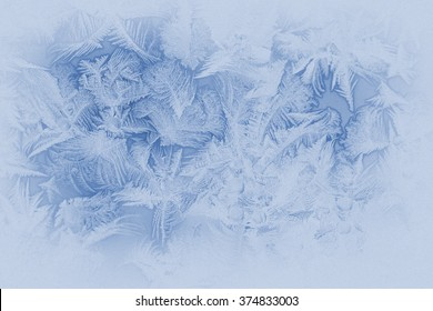 Beautiful frost pattern on a window glass (in subdued colors, retro style)