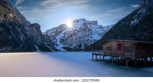 Beautiful frozen alpine lake with a wooden hut. Lago di Braies in winter