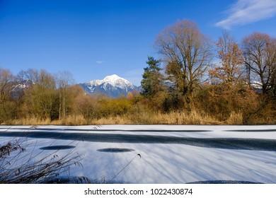 Beautiful frozen Bobovek lakes in winter near Kranj in Slovenia