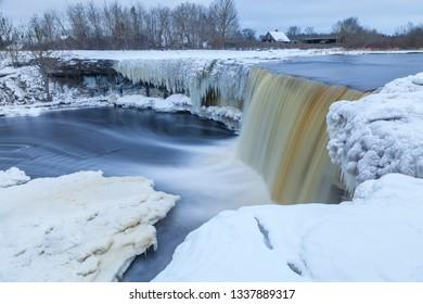 Beautiful frozen waterfall in winter. Jagala, Estonia, Eastern Europe.