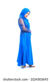 Beautiful full body Southeast Asian Muslim woman posing in Islam Dress or Hijab isolated on white background.