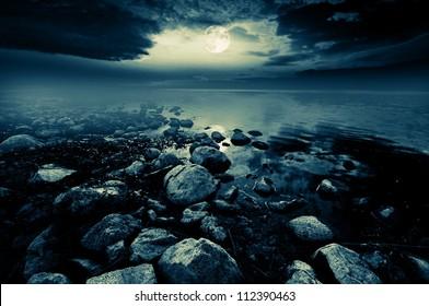 Beautiful full moon reflecting in a lake