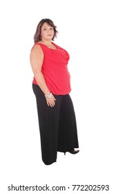Beautiful full sized woman standing in a red blouse and black trousers