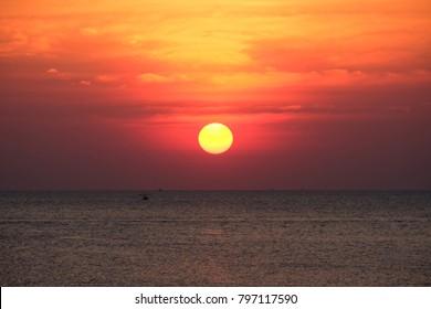 Beautiful full sun with sunset sky, sunset today and sunset tonight, sunset saturday in the Chaolao Beach Chanthaburi Thailand.
