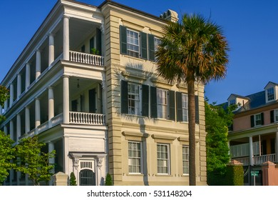 Beautiful full view of a Charleston Mansion in the Battery district, With a stately palmetto tree. A great image for use with Real Estate business - or vacation tours. Gotta love Charleston!
