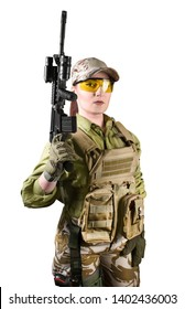 Beautiful fully equipped military soldier woman in protective armor tactical vest, camouflage pants, gloves, cap and glasses holding an automatic rifle M16, isolated photo.