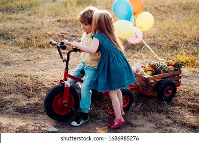 Beautiful fun day for cute friends in nature. Little cute kids are smiling. Children outdoors in nature. Little children have fun on fresh air. Happy brother and sister