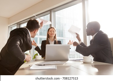 Beautiful funny businesswoman keeping calm in stressful situation at work, refusing pay attention to difficulties or misunderstanding during negotiations, ignoring excited angry colleagues on meeting
