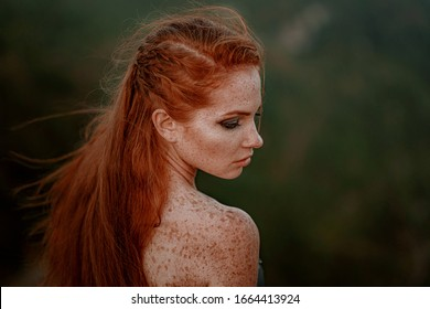 beautiful furious scandinavian warrior ginger woman in grey dress with metal chain mail. Woman is a Viking. Fantasy. Book Cover. Close-up portrait. Cinematic look