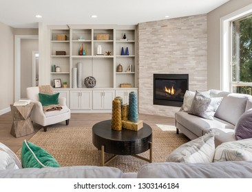 Beautiful Furnished Living Room Interior in New Luxury Home. Features Built-In Shelves and Cabinets, Along with Fireplace and Hardwood Floors