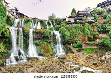 Beautiful Furong waterfall in Hibiscus Ancient Town, Xiangxi Hunan, China.