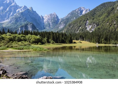 Beautiful Fusine lakes, nature, countryside, trees and mountains on background. Tarvisio (Udine), Friuli Venezia Giulia, Italy