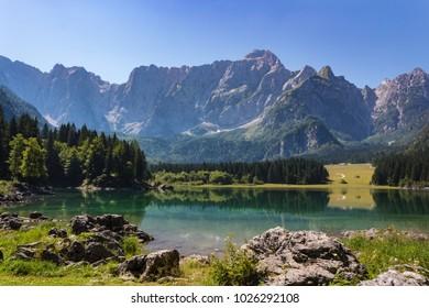Beautiful Fusine lakes, nature, countryside, trees and mountains on background. Tarvisio (Udine), Friuli Venezia Giulia, Italy.