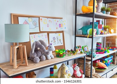 Beautiful games corner with lots of toys and draws at kindergarten