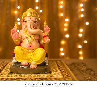 Beautiful Ganesha idol against decorative background. Clear space for text on the poster or greeting card for Ganesh Festival.
