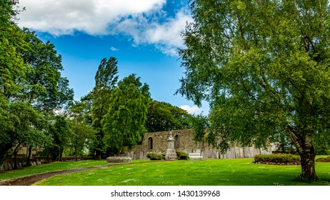Beautiful garden of the Abbey Graveyard with green grass a path in the town of Athlone, wonderful sunny spring day in the county of Westmeath, Ireland