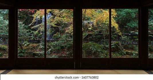 Beautiful garden in autumn View through the silhouette door frame.