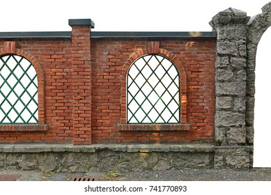 beautiful garden fence brick wall with window grills. brick stone prefabricated fence section isolated over white background