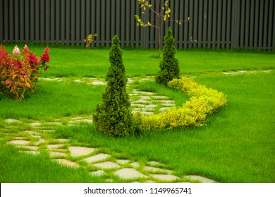 Beautiful garden in front of a villa house