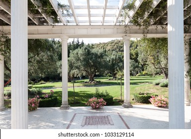 Beautiful garden house (arbour) for relaxing in the park on a sunny summer day
