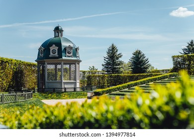 Beautiful garden house, green lawn with blue sky and clouds in park, Rundale, Latvia