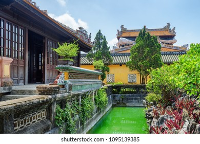 Beautiful garden and old buildings of the Purple Forbidden City at the Imperial City in Hue, Vietnam. Hue is a popular tourist destination of Asia.