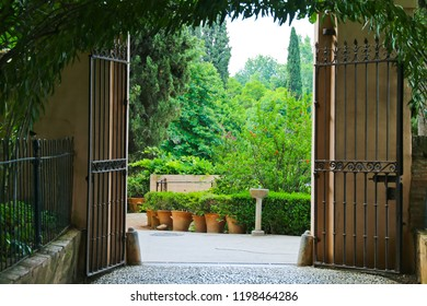 A beautiful garden viewed through door outside, Alhambra palace in Granada, Spain