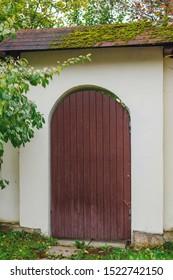 Beautiful gate in autumn garden in countryside