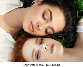 Beautiful gay couple sharing time together and having fun outdoor. Women friendship. Girls in boho fashion clothes. Happy girlfriends having tender moments. LGBT and relationship concept