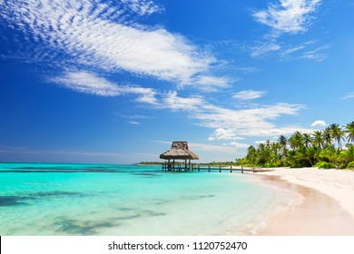Beautiful gazebo on the tropical white sandy beach in Punta Cana, Dominican Republic