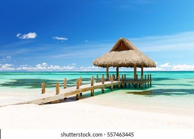 Beautiful gazebo on the tropical white sandy beach in Cap Cana, Dominican Republic