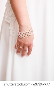 Beautiful gentle hand of the bride with a wedding ring
