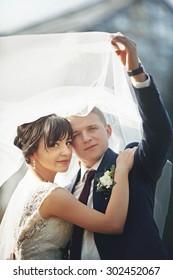 beautiful gentle romantic  couple under veil, outside, park, summer, Lviv