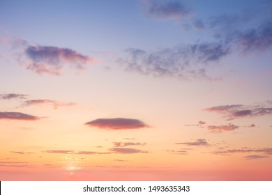 Beautiful Gentle Sky Clouds Background at Sunset time, natural colors, may use for wallpaper