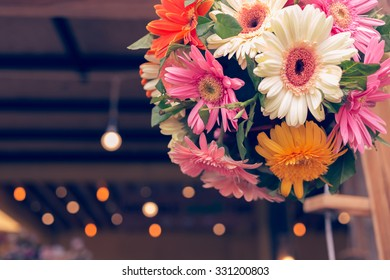 beautiful gerbera flower bunch with light decoration in wedding ceremony day