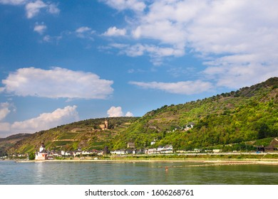 Beautiful German landscape with tiered vineyard and village seen from the middle Rhine River.