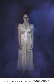 Beautiful ghost woman in white victorian dress. Halloween scene
