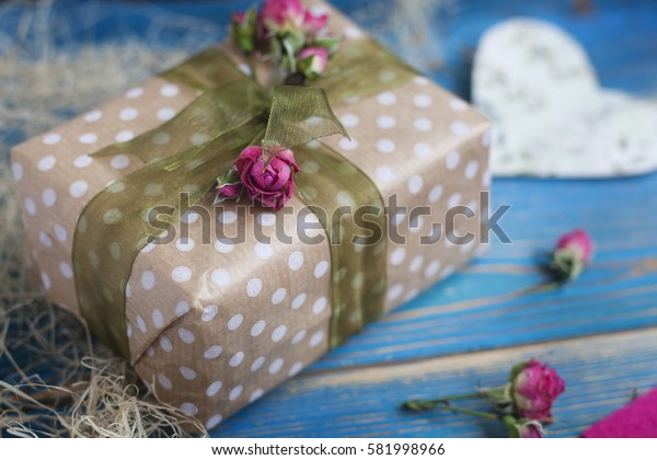 Beautiful gift box on a blue wooden background