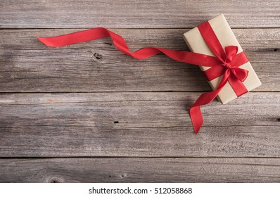 Beautiful gift box on a wooden background.