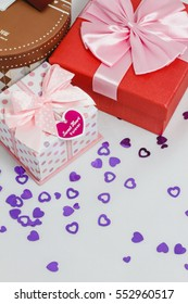 Beautiful gift boxes favorite on a white background with hearts