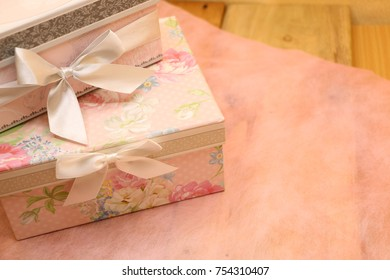 beautiful gift boxes on pink paper.