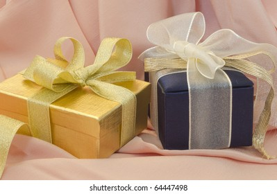 beautiful gift boxes on the silk background