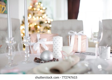 Beautiful gift boxes on the table. Christmas background. (soft focus)